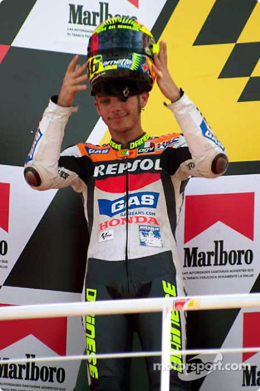 Valentino Rossi raises helmet to crowd