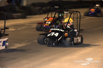 Dirt World Championships: #14-Brandon Bull looks for the inside line in Briggs Junior Champs during the Dirt World Championships at Daytona Beach Municipal Stadium.