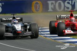 Michael Schumacher tries to pass Kimi Raikkonen