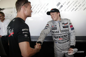 David Coulthard congratulates Kimi Raikkonen for his first win
