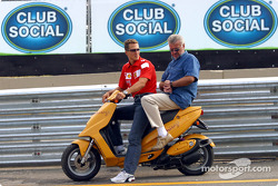 Michael Schumacher and manager Willi Webber on a scooter