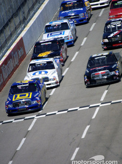 Bobby Hamilton leads the field at a restart