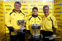 Gary Anderson, Giancarlo Fisichella and Eddie Jordan with the Brazilian GP winner's trophy