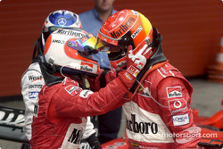 Rubens Barrichello congratulates Michael Schumacher