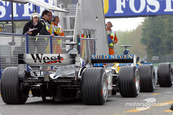 Pit exit: Fernando Alonso and David Coulthard