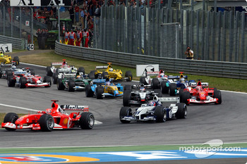 First corner: Michael Schumacher leads Juan Pablo Montoya