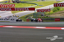 Michael Schumacher leads as the field approaches Remus Kurve