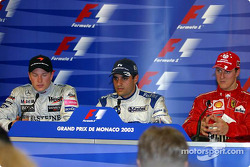 Press conference: race winner Juan Pablo Montoya with Kimi Raikkonen and Michael Schumacher