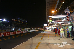 Pitlane activity at midnight