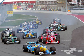 The start: Fernando Alonso leads the rest of the field
