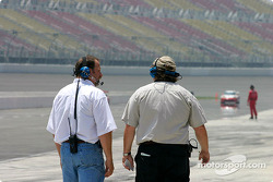 Crew watching the cars qualify