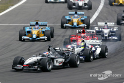 The start: Kimi Raikkonen takes the lead in front of Ralf Schumacher