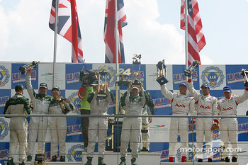 Podium: overall winners Tom Kristensen, Rinaldo Capello, Guy Smith, with Johnny Herbert, David Brabham, Mark Blundell, and J.J. Lehto, Emanuele Pirro, Stefan Johansson
