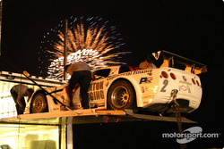 Revolution Motorsports crew members pack material under fireworks