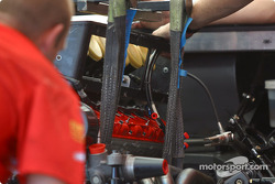 Prodrive Racing team members put V12 powerplant in place