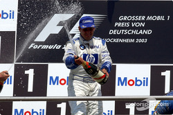 The podium: champagne for race winner Juan Pablo Montoya