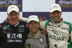 The podium: race winner Scott Pruett with Johnny Miller and Tomy Drissi