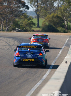 Marcos Ambrose follows team mate Russell Ingall into turn 1