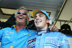Flavio Briatore and Fernando Alonso celebrate pole position