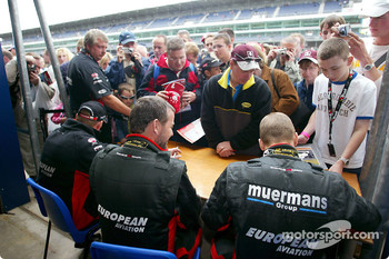Autograph session for Jos Verstappen, Paul Stoddart and Gianmaria Bruni