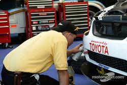 A Team FBR/Trans Sport crew member works on a team car