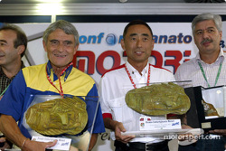 Award ceremony with Michelin's Pierre Dupasquier and Bridgestone's Hiroshi Okuda