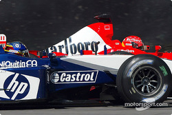 Michael Schumacher battles with Juan Pablo Montoya