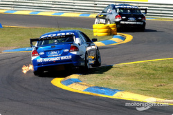 David Besnard follows team mate Craig Lowndes through the dog leg