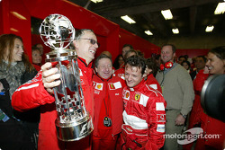 Jean Todt and Ferrari team members celebrate win