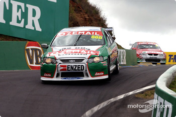 John Cleland with Paul Dumbrell in pursuit