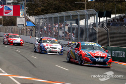Russell Ingall fends of Greg Murphy and Mark Skaife on the last lap