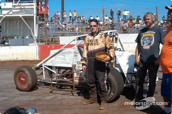 Ronnie Clark recieves another koa wood bowl trophy for third