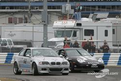 #92 Anchor Racing BMW M3: John Munson, James Sofronas, Scott Galaba, passes #91 Doncaster Racing Porsche 996: Kenny Wilden, Robert Julien for the lead