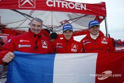 Guy Fréquelin, Sébastien Loeb and Daniel Elena celebrate win