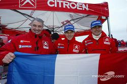 Guy Fréquelin, Sébastien Loeb and Daniel Elena celebrate win