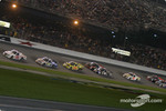 Carl Edwards leads the field on a restart