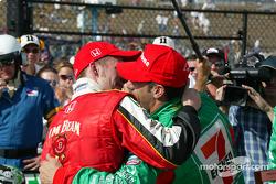 Tony Kanaan celebrates with Dan Wheldon