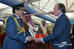His Majesty The King, Shaikh Hamad bin Isa Al Khalifa presents Sir Jackie Stewart with the Bahrain Order at the Bahrain International Circuit during the official opening
