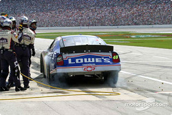 Lugs fly as Jimmie Johnson leaves the pit box
