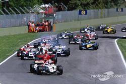 Start: Jenson Button leads Michael Schumacher