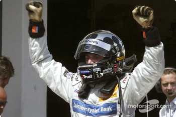 Race winner Christijan Albers celebrates