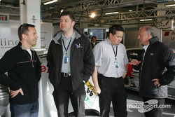 Jamie Davies, John Neman and Sam Li from Audi Sport UK Team Veloqx with Siegfried Krause in the Audi pits