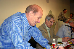 Robert Donner and Vic Elford signing autographs