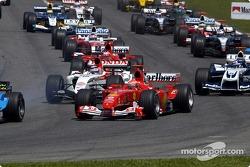 First corner: Michael Schumacher and Takuma Sato