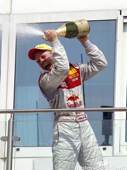 Podium: champagne for race winner Mattias Ekström
