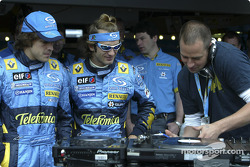 Jarno Trulli and Fernando Alonso watch DJ Tom Novy mixes on his decks