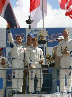 GT podium: winners Sascha Maassen, Jorg Bergmeister, Patrick Long