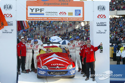 Podium: winners Carlos Sainz and Marc Marti celebrate with Sébastien Loeb, Daniel Elena and Corrado Provera