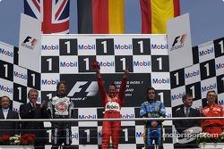 Podium: race winner Michael Schumacher with Jenson Button and Fernando Alonso