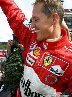 Podium: Michael Schumacher celebrates World Championship